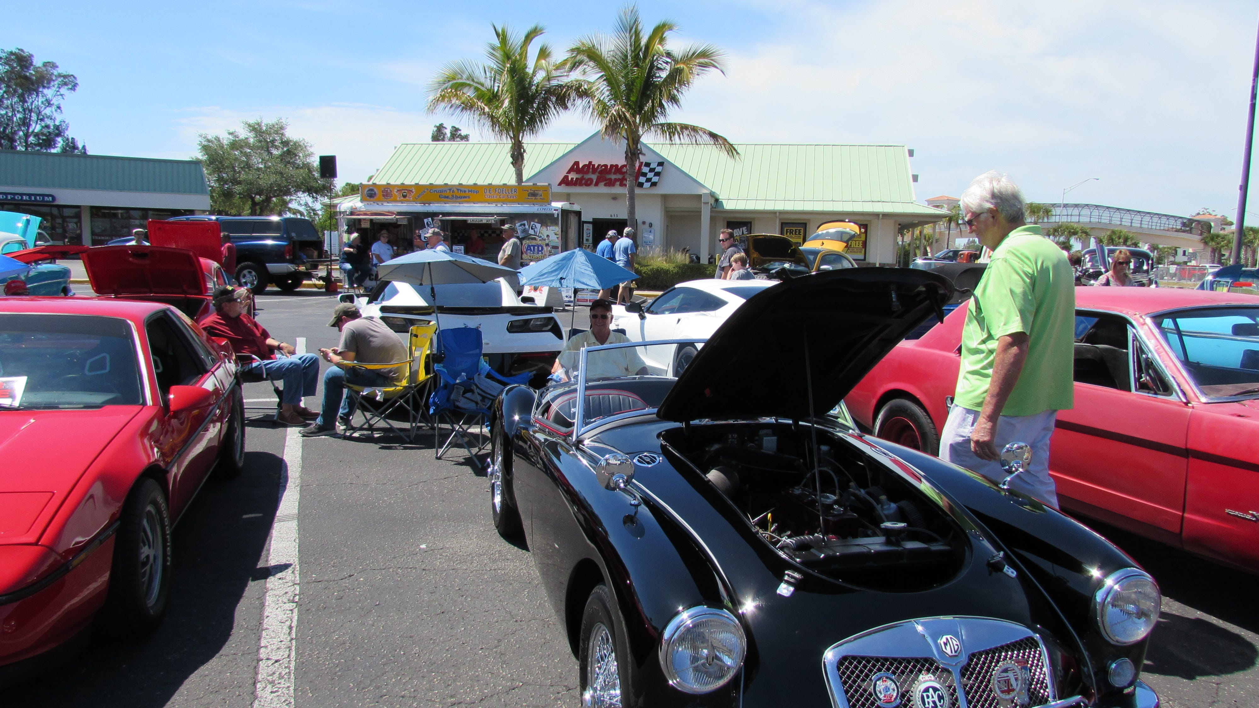 A 1957 MGA Roadster is on display at a Lance's Cruzin to the Hop auto show in the parking lot of show sponsor Advance Auto Parts of Venice.