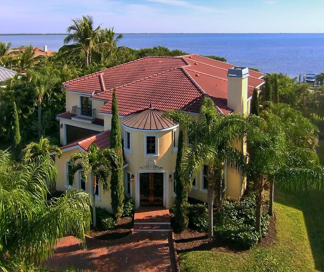 A spacious and gracious home at 5372 Sandhamn Place on  Longboat Key is on the market for $3,850,000 million through Richard Perlman of Michael Saunders & Company. [Photo / pix360]