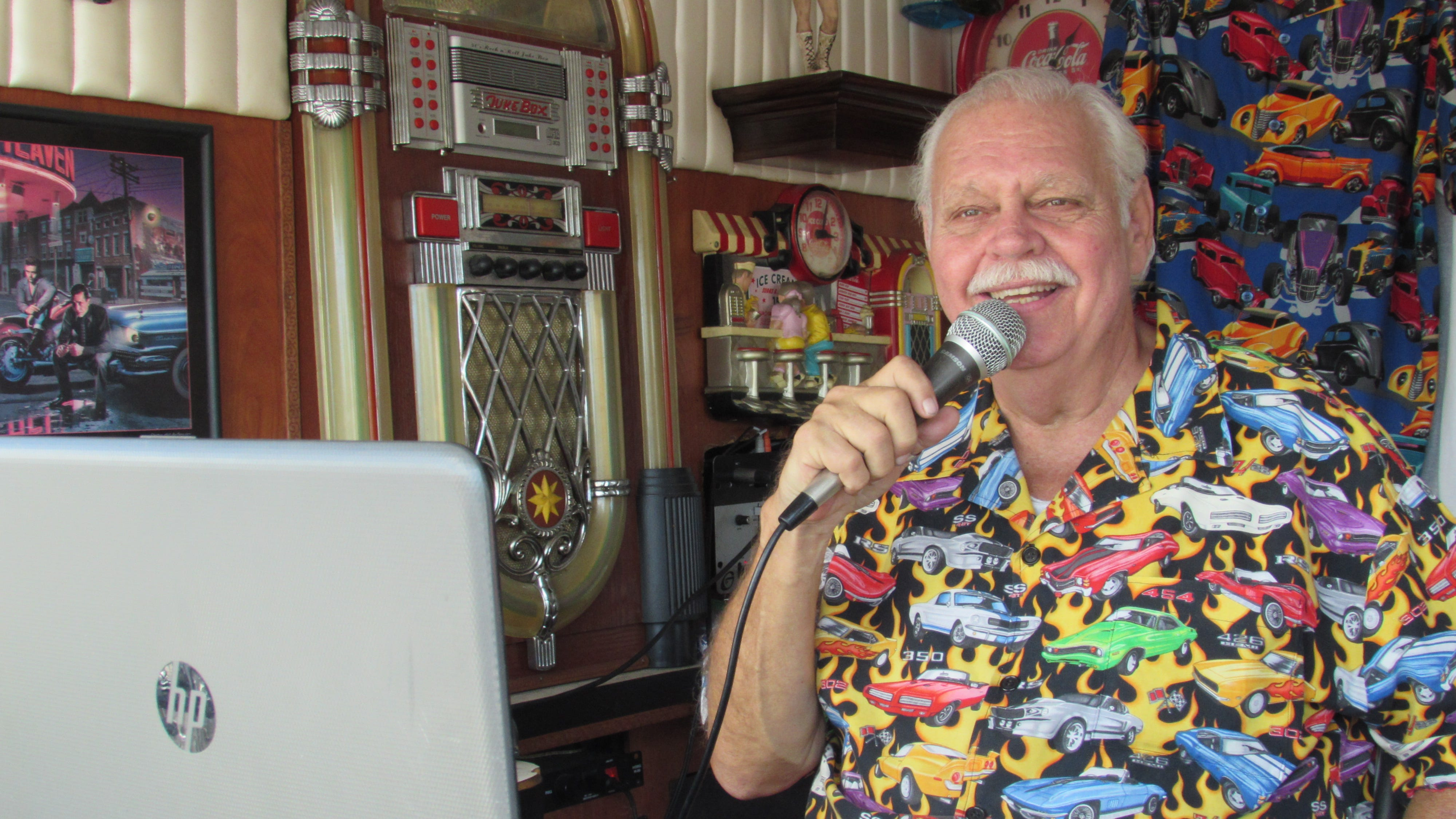 Lance Hubschmitt, popular D.J. and owner of Lance's Cruzin to the Hop, emcees an auto show. He's been bringing classic autos to the people of Southwest Florida for decades.