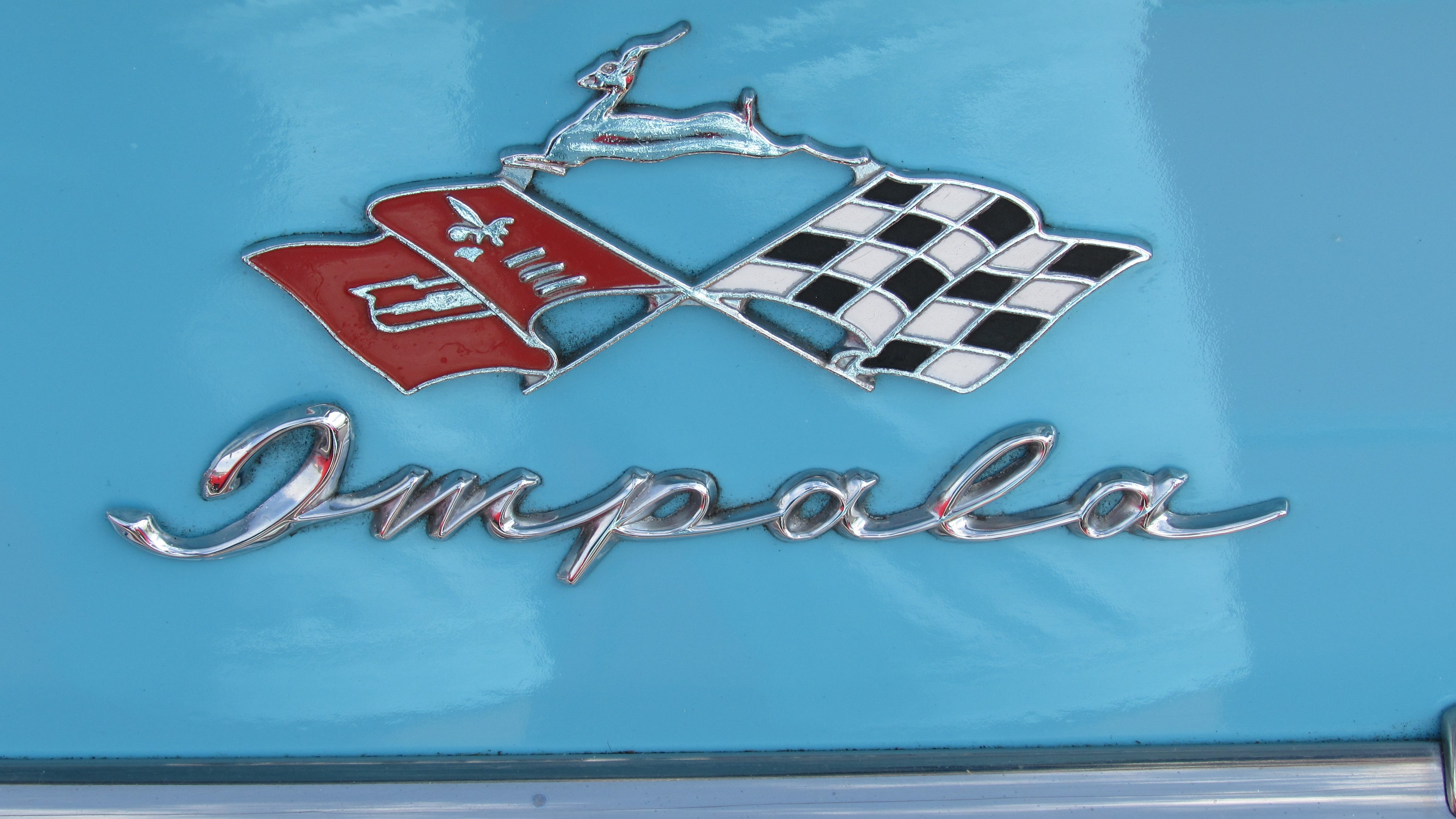 There are many decorative parts to cars, including logos such as this Impala's.