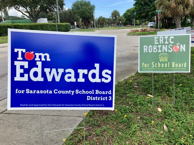 Campaign signs for candidates for the Sarasota County School Board are displayed outside the Sarasota County Supervisor of Elections office in downtown Sarasota.