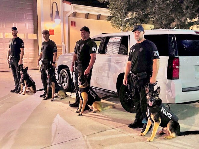 North Port Police Department received a donation of bullet and stab protective vests from the nonprofit Vested Interest in K9's Inc. Pictured from left: North Port Police Dog Bear and handler, Officer Drake Sunderland; Nero and handler Officer Justin Bumgarner; Dutch and handler Officer Chad Walker; and Jett and handler officer Justin Lindsey.