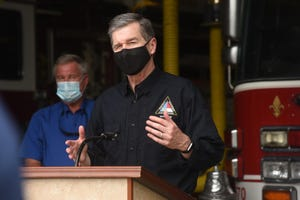 Governor Roy Cooper speaks Aug. 6 during a visit to Oak Island following Hurricane Isaias. On Thursday, Cooper announced a new grant program to help businesses pay their employees during the COVID-19 shutdown. [KEN BLEVINS/STARNEWS]