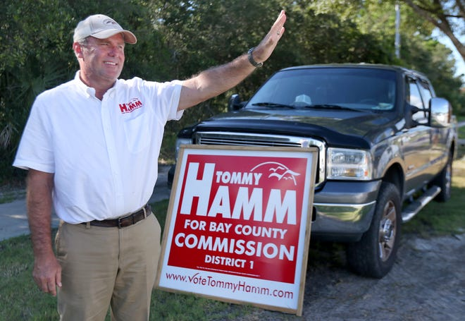 Tommy Hamm waves to motorists on Aug. 30, 2016 at Frank Brown Park.