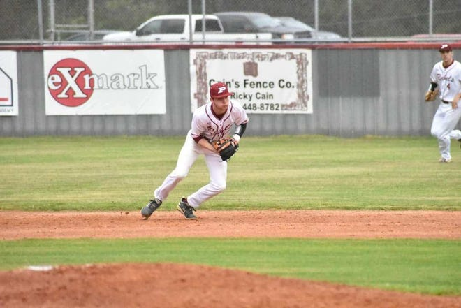 Pineville utility player Evan Atkins gets ready to field a ground ball during the 2020 baseball season. Atkins recently signed with Belhaven.