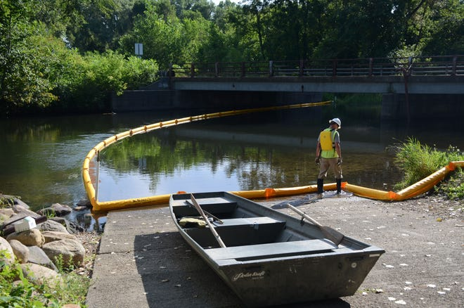 Workers from Wolverine Pipe Line Co. trained Thursday for a petroleum spill on the Kalamazoo River.  Trace Christenson/The Enquirer