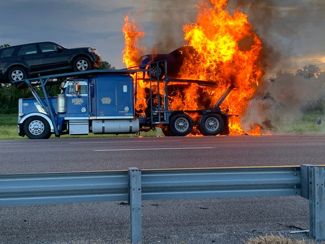 I-95 near Port St. John was closed Wednesday evening as firefighters responded to a burning tractor and trailer carrying passenger vehicles.