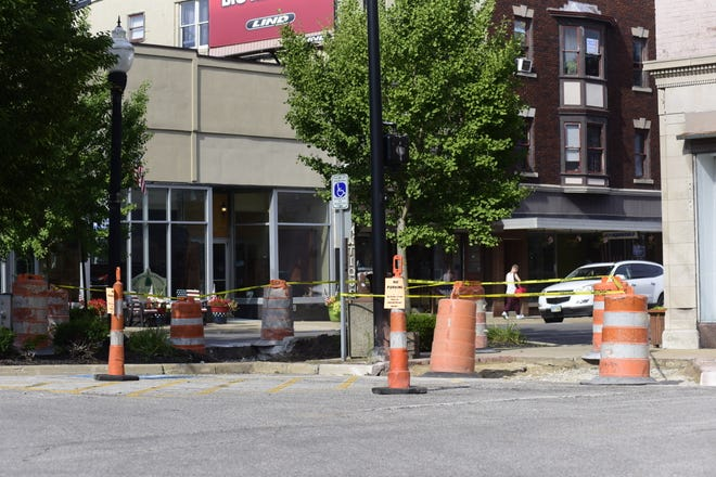 Portions of downtown Galion are blocked off as crews repair the city's sidewalks.
