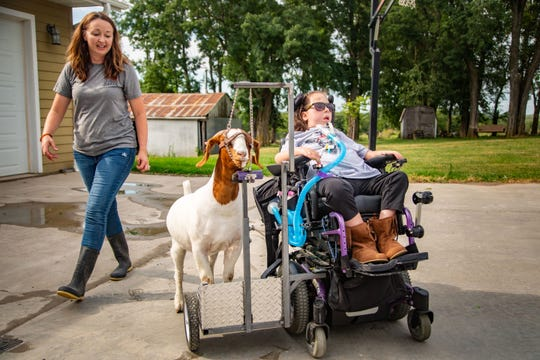 Stella Turnbull, 13, and her mother Sarah train to show her goat Bella in the Iowa State Fair at her home outside Pella Monday, Aug. 10, 2020.