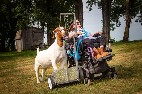 Stella Turnbull, 13, trains to show her goat Bella in the Iowa State Fair at her home outside Pella Monday, Aug. 10, 2020.