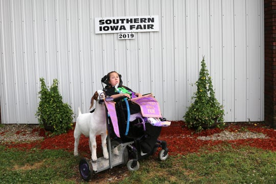 Hand out photo of Stella Turnbull and her goat, Lou, after winning supreme doe in the meat goat class at Southern Iowa Fair in 2019.