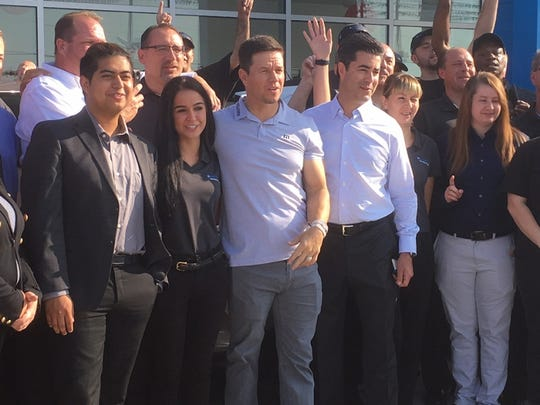 (In the center) Mark Wahlberg and Jay Feldman met with the Mark Wahlberg Chevrolet dealership team in Columbus, Ohio in November 2018. The two co-own the dealership.