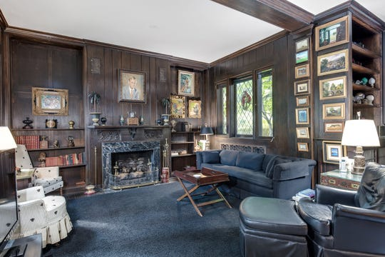 The library was a 1920s addition that brought in extra flourishes. It has a finely carved fireplace, diamond-shaped leaded glass windows and a stained-glass inset.