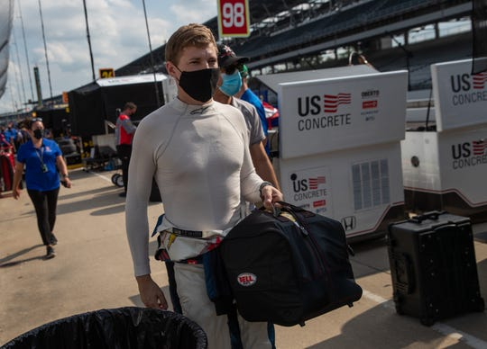 DragonSpeed USA driver Ben Hanley (81) makes his way to his pit area after the first day of practice for the 104th Indianapolis 500 at Indianapolis Motor Speedway on Wednesday, Aug. 12, 2020.