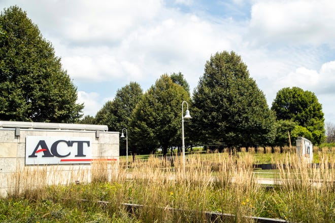 Signs along Scott Boulevard outside the ACT campus on ACT Place are seen, Thursday, Aug. 13, 2020, in Iowa City, Iowa. ACT is an Iowa City-based nonprofit organization formerly known as American College Testing.