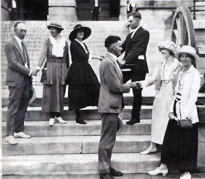 National Woman's Party members thanking legislators outside the State Capitol after the vote. Harry Burn is in the dark suit just right of center, in the background, shaking hands with Anita Pollitzer. On the far left is Banks Turner, shaking hands with Catherine Flanagan. In front are Thomas Simpson and NWP activists Betty Gram and Sue White.