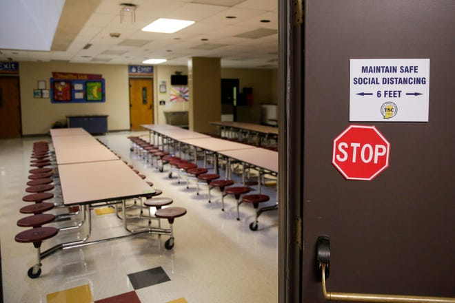 A sign is posted at the entrance to the cafeteria at Dayton Elementary, Thursday, Aug. 13, 2020 in Dayton.