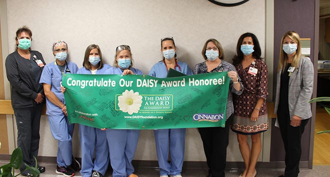 Julie Fuller (fourth from the right) was honored with the DAISY Award for Extraordinary Nurses.