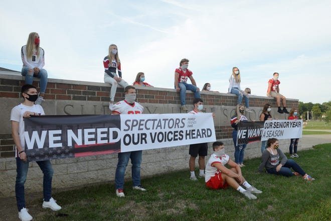 A group of Shelby students and athletes gathered outside their high school Wednesday evening, calling for a season, or one as close to normal as possible.