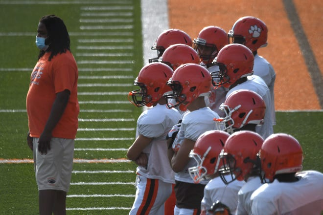 Tyger players watch drills Wednesday evening during practice at Arlin Field.