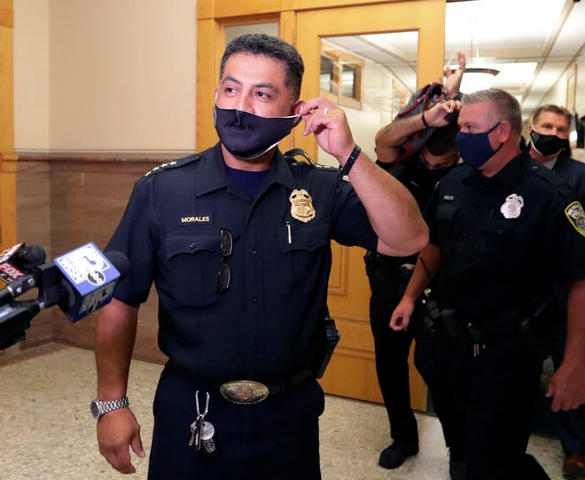 Milwaukee Police Chief Alfonso Morales leaves a meeting and introduces his attorney, Frank Gimbel. Gimbel said he served on the Fire and Police Commission for five years and said the commission appears to be setting up Morales with directives following a meeting on July 20, 2020.