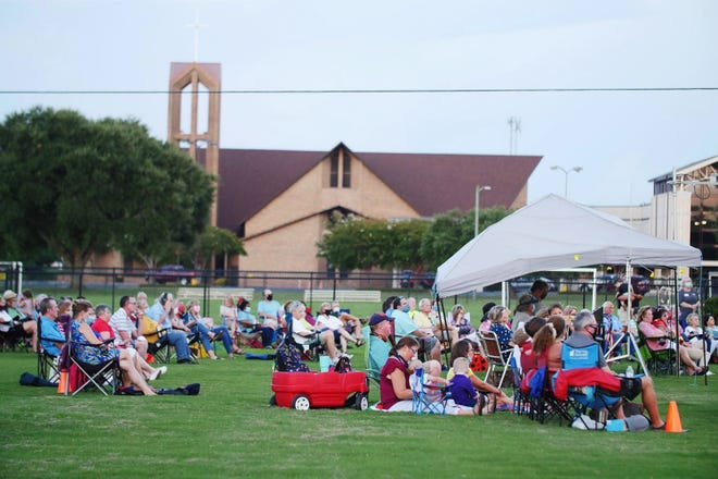 Members and guests of Frazer church enjoy worship on a Saturday evening. Frazer will be offering outdoor worship services on church soccer fields on Saturday nights at 7 p.m. through Aug. 29.