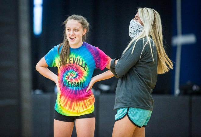 Daleville coach Valorie Flick (right) instructs her volleyball team during a practice at Daleville High School Thursday, Aug. 13, 2020.