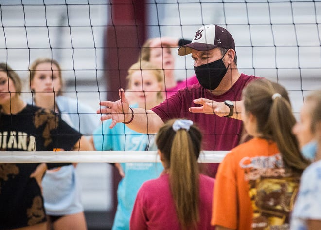 Wes-Del volleyball coach Biff Wilson instructs his team as it prepares for the start of the season Wednesday, Aug. 12, 2020.