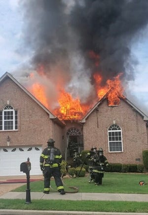 Nashville Fire Department crews battled a house fire in North Nashville that critically injured a woman on Thursday, Aug. 13, 2020.