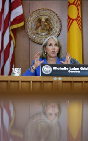 New Mexico Gov. Michelle Lujan Grisham speaks Thursday, Aug. 13, 2020, at a news briefing at the state Capitol building in Santa Fe.