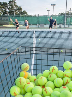 """Students run a drill during a """"Love to Learn"""" adult beginner class at the Roger Scott Tennis Center in Pensacola on Wednesday, August 12, 2020."""