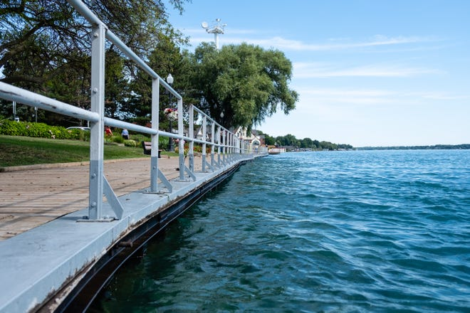 The St. Clair River is high against the boardwalk in Palmer Park Thursday, Aug. 13, 2020, in St. Clair. While Lake St. Clair and Lake Michigan-Huron are still at record highs, experts expect levels to retreat moving into the fall months.