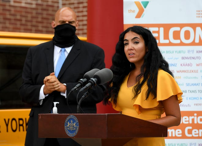 Second Lady Gisele Fetterman, speaks to the latino community as she, husband Lieutenant Governor John Fetterman, left, Governor Tom Wolf and Secretary of Health Dr. Rachel Levine visit the York County YMCA to announce the findings of the Wolf Administration's COVID-19 Response Task Force for Health Disparity, Thursday, August 13, 2020.John A. Pavoncello photo