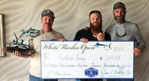 North Codorus Township's Travis Ort, left, is pictured after a tuna he caught in the White Marlin Open won more than $1.4 million in prize money. At center is mate Bryan Hazard and at right is Matt Russ, from Wrightsville.