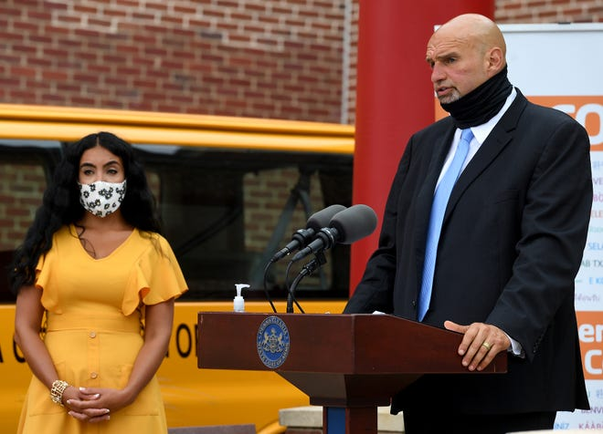 Lieutenant Governor John Fetterman, along with Second Lady Gisele Fetterman, left, visit the York County YMCA to announce the findings of the Wolf Administration's COVID-19 Response Task Force for Health Disparity, Thursday, August 13, 2020.John A. Pavoncello photo