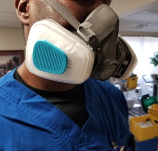 Colin Evans, 18, of Hampstead, Maryland, has used a 3D printer to produce over 130 ear savers and mask filter caps for Carroll Hospital for medical providers who work there. Credit: Leigh Ann Evans