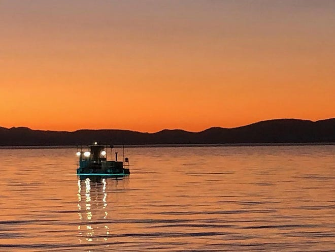 UV lights mounted on a barge are used to treat invasive aquatic plants at Lake Tahoe.