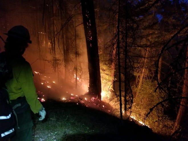 Crews battle the Mosier Creek Fire on Friday night.