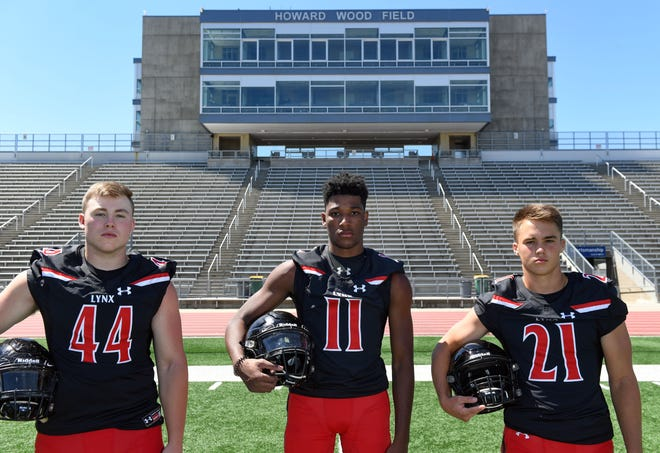 Parker Reed, Jackson Hilton and Tate Johnson of Brandon Valley pose for a portrait during football media day on Tuesday, August 11, at Howard Wood Field in Sioux Falls.