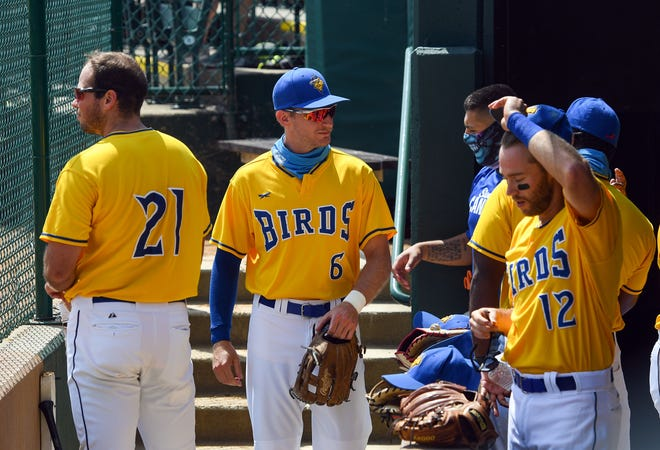 Logan Landon, center, enters the dugout after the first inning of a Canaries game against the St. Paul Saints on Wednesday August 12, at the Birdcage in Sioux Falls.