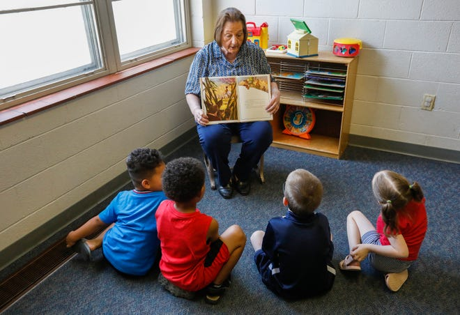 Janice Sartin, director of Grant Avenue Baptist Church Day Care, reads a book to a small group of children on Thursday, Aug. 13, 2020. The day care will close on Aug. 21 after 65 years of operation.