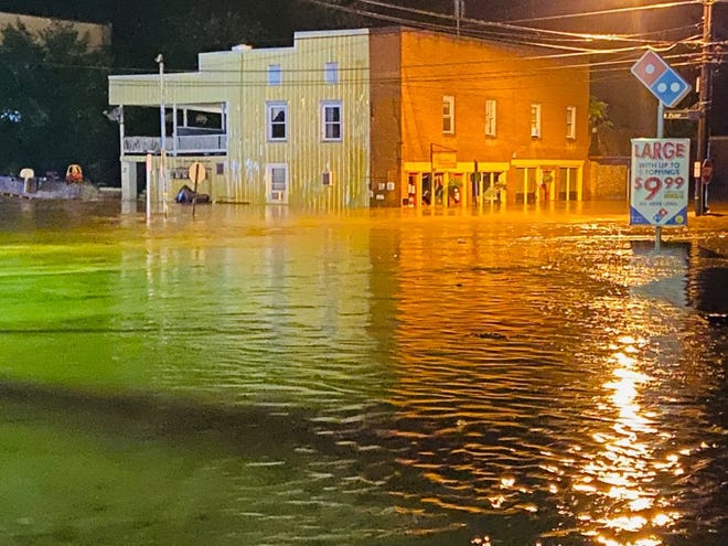 Waters rise at the intersection of Lewis and Pump streets by Gloria's Pupuseria on Aug. 8, 2020 when a flash flood hit downtown Staunton.