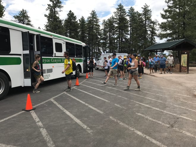 Passengers board Bryce Canyon National Park Shuttles, which were replaced in 2016.