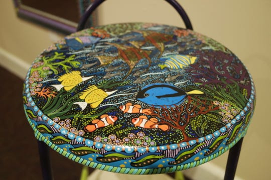Doell West's hand-painted furniture works are on display at the Gadsden Arts Center & Museum's Munroe Family Community Gallery.