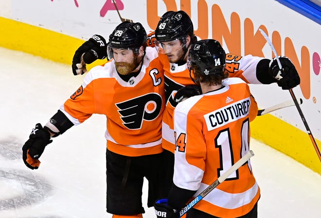 Philadelphia Flyers' Joel Farabee (49) celebrates his goal against the Montreal Canadiens with teammates Claude Giroux (28) and Sean Couturier (14) during the second period of an NHL Eastern Conference Stanley Cup first-round playoff game in Toronto, Ontario on Wednesday, Aug. 12, 2020.