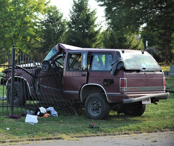 A female driver and male passenger were taken to Genesis Hospital after a one-car crash on Thursday. The driver lost control and went through the metal barrier of Woodlawn Cemetery off Pershing Road.