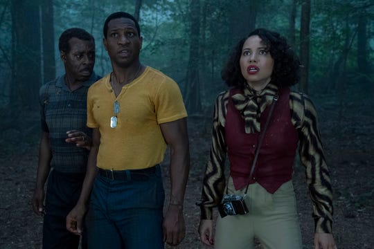 "George (Courtney B. Vance, far left), Atticus (Jonathan Majors) and Leti (Jurnee Smollett) find monsters, of both the human and supernatural kind, in HBO's ""Lovecraft Country."""