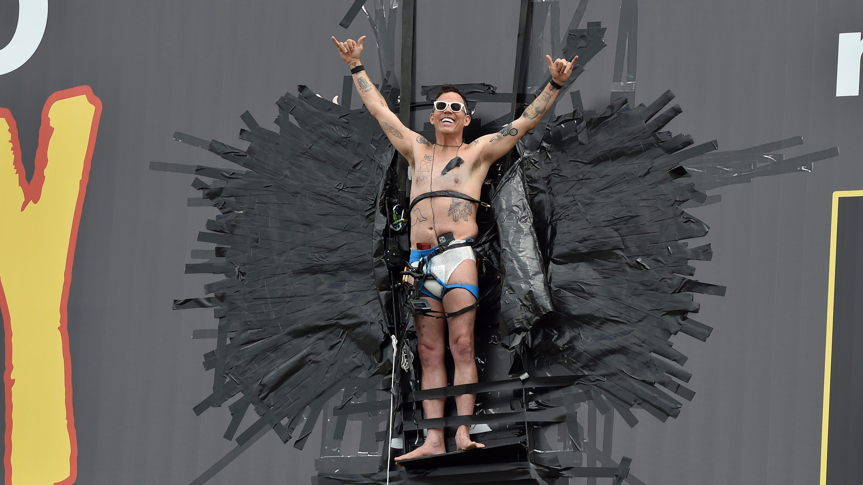 'Jackass' Steve-O duct tapes self to Hollywood billboard in diaper, removed by fire department
