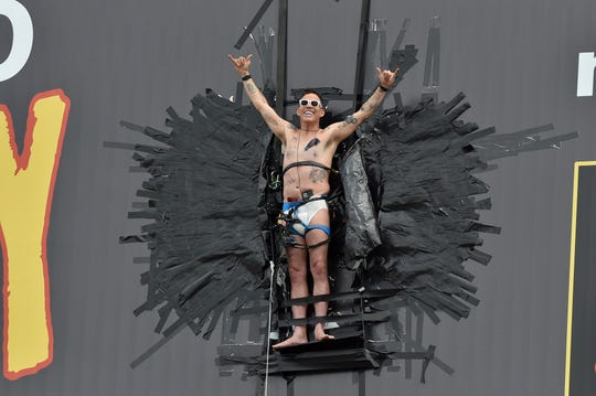 Steve-O duct tapes himself to billboard in promotion of his new TV special.