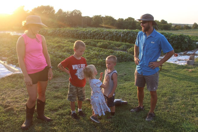 Robin and Whitney Brown, along with their children Parker, Oliver and Emma enjoy an afternoon summer on their family's  Phoenix Farm.